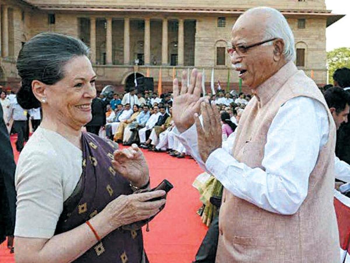 AND THE TWAIN MET: Senior BJP leader LK Advani and Congress President Sonia Gandhi exchanging pleasantries.