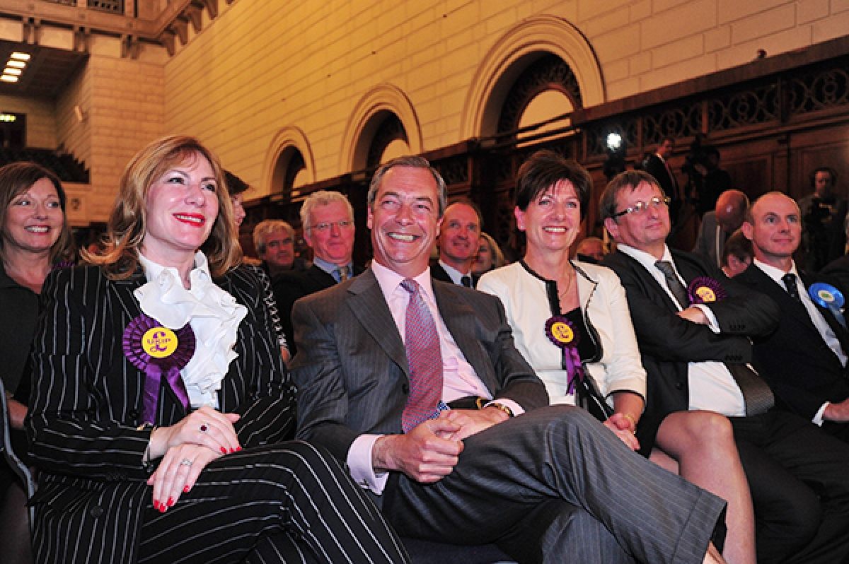 UK Independence Party (UKIP) leader Nigel Farage (2L) smiles sitting with UKIP MEP candidates Janice Atkinson (L) and Diane James (3R) and Ray Finch (2R) as the South East England region results of the European Parliament elections are declared by the returning officer at Southampton Guildhall in Southampton, southern England, on Sunday.