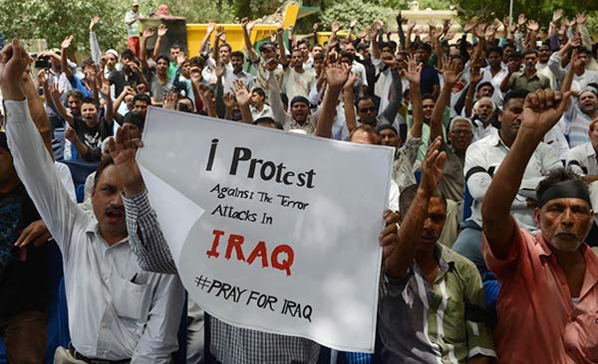 Muslims shout anti-terrorism slogans and demand an end to the fighting in Iraq during a demonstration in New Delhi onSaturday.   India announced it would stop granting its nationals permission to travel to Iraq for work on as it stepped up efforts to secure the release of 39 Indians abducted by gunmen.
