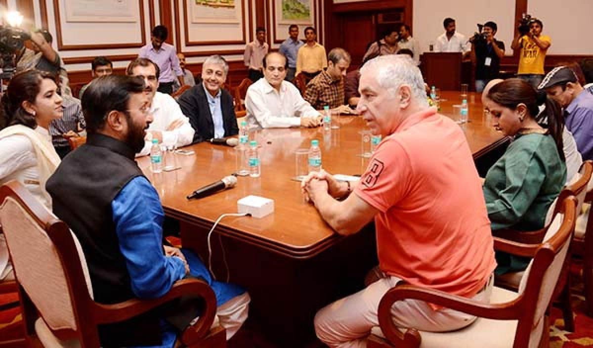 Minister for Information and Broadcasting Prakash Javadekar, actor Dalip Tahil, BJP leader Shaina N C and others at the meeting in Mumbai.