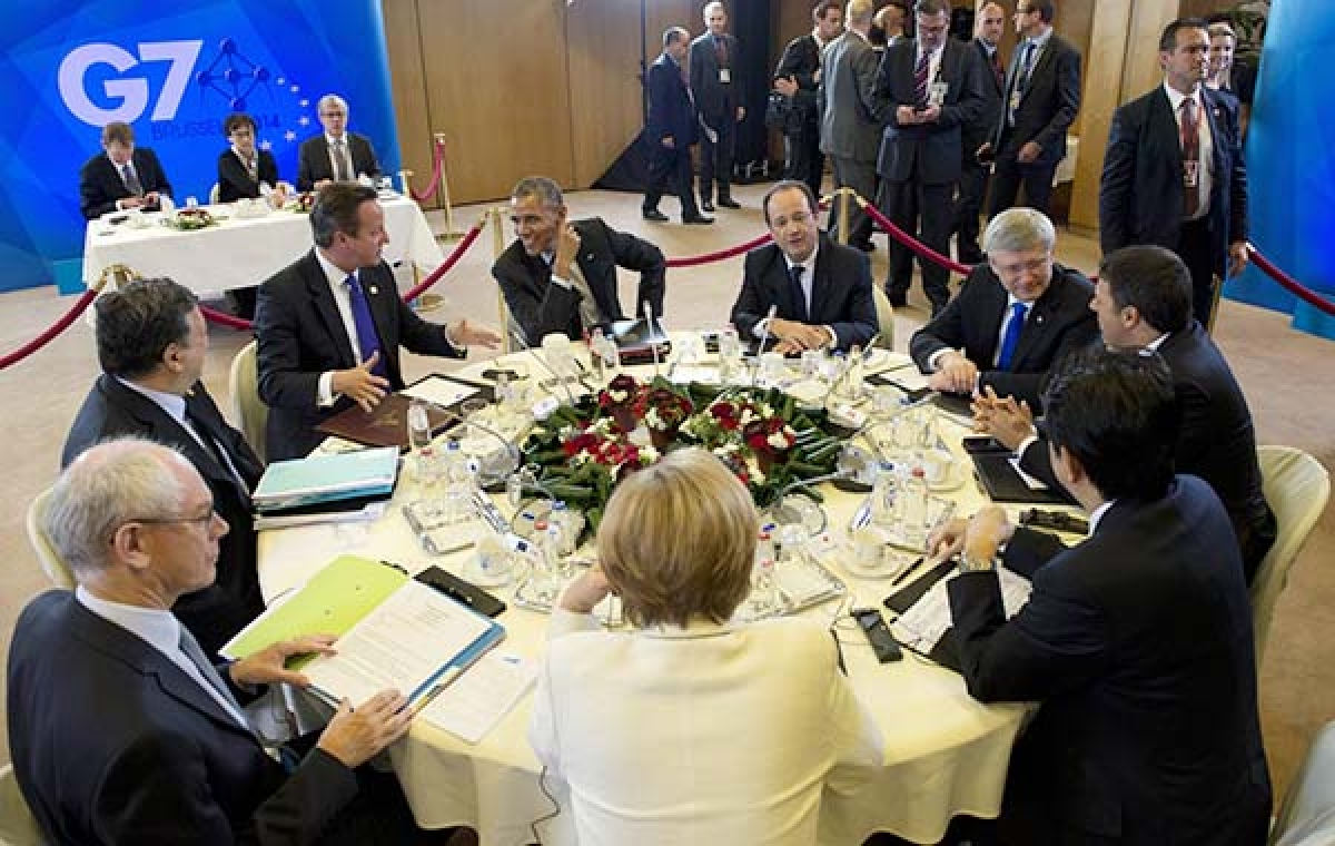 (From L-R, clockwise) German Chancellor Angela Merkel, British Prime Minister David Cameron, US President Barack Obama, French President Francois Hollande, Canadian Prime Minister Stephen Harper, Italian President Matteo Renzi, and Japanese Prime Minister Shinzo Abe speak as they participate in a session dedicated to the global economy during the G7 Summit at the European Council in Brussels, Belgium.