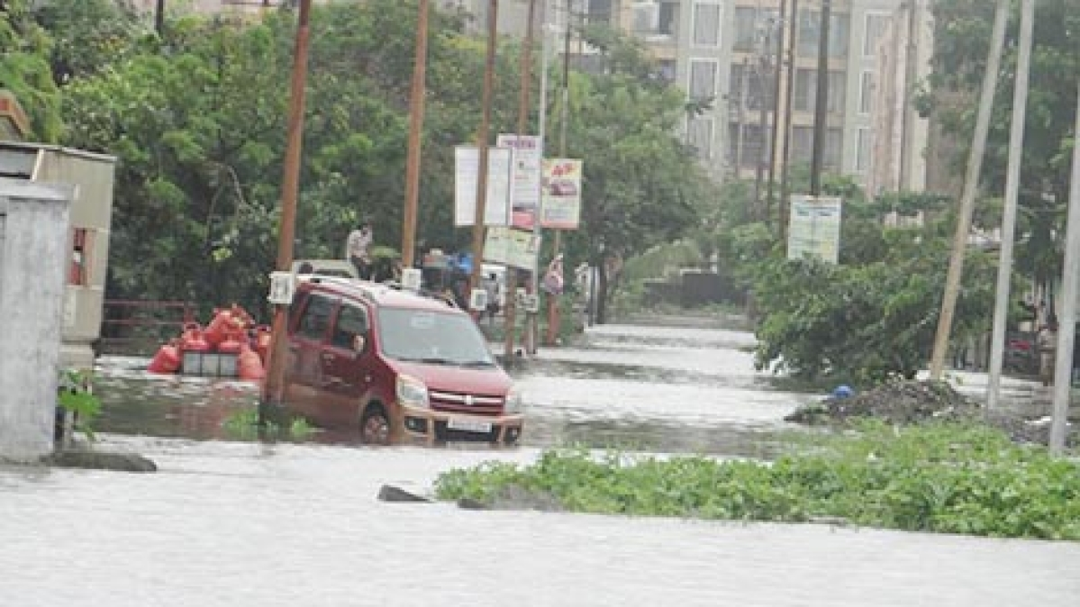 A car stuck in one of the flooded roads in Vasai