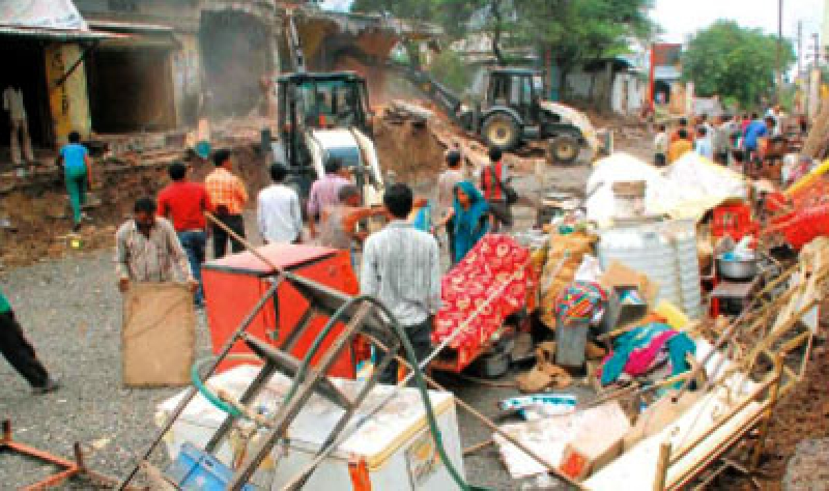Shops, boundary wall of ashram, temple removed for road widening