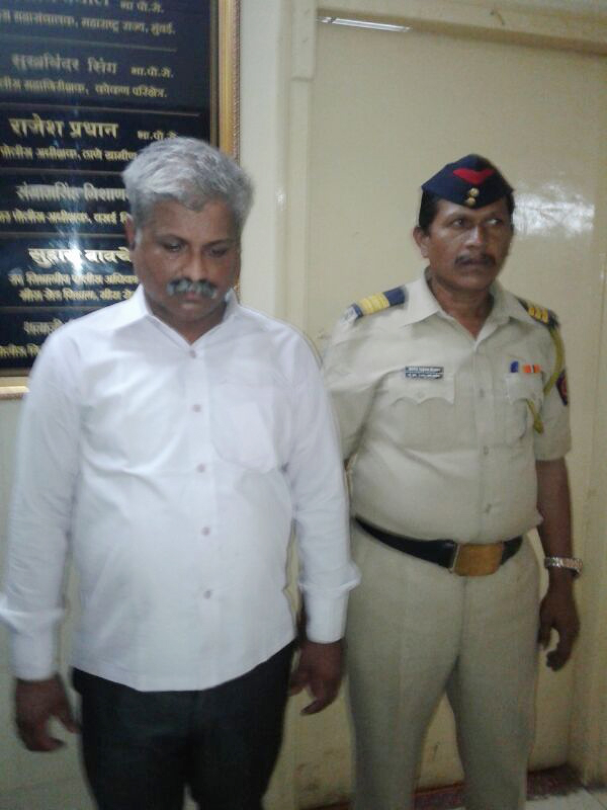A habitual offender by profession, Lalit  Omprakash Sawant (L)  moved around in an SUV with official patrolling books and weekly diaries.