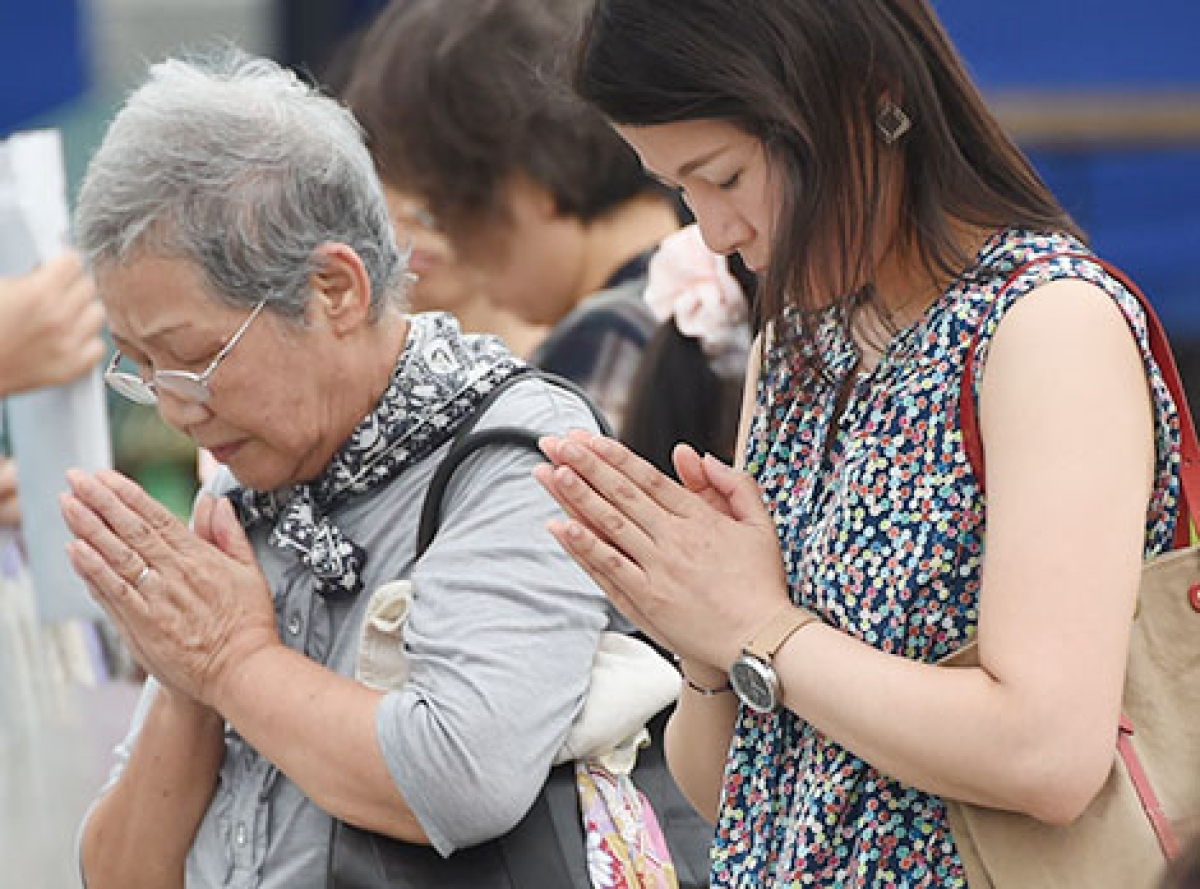 People pray for the victims of the 1945 atomic bombing at the Peace Memorial Park in Hiroshima on Tuesday.  The Japanese  city will mark the 69th anniversary of the world's first atomic attack on August 6.