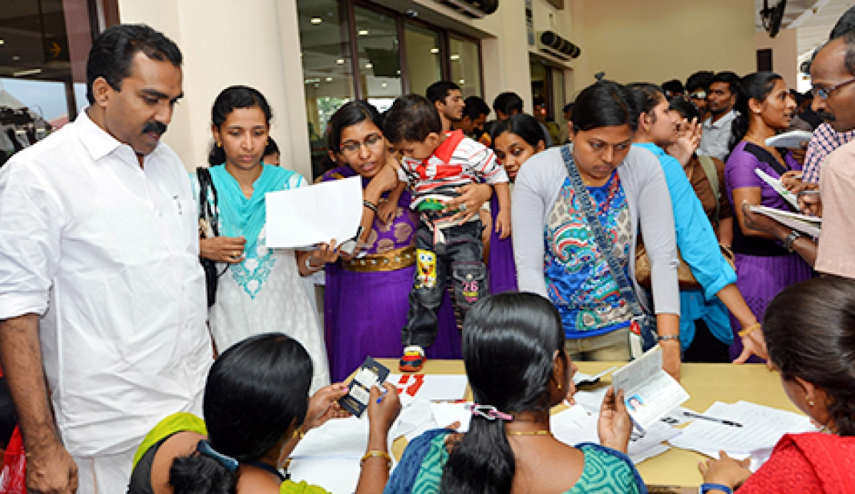 Left: Nurses from Libya arrive at Cochin airport onTuesday. They are received byAnwar  Sadath, MLA and Roots- Norka CEOSudeep.  Right: Nurses registering a Norka helpdesk.