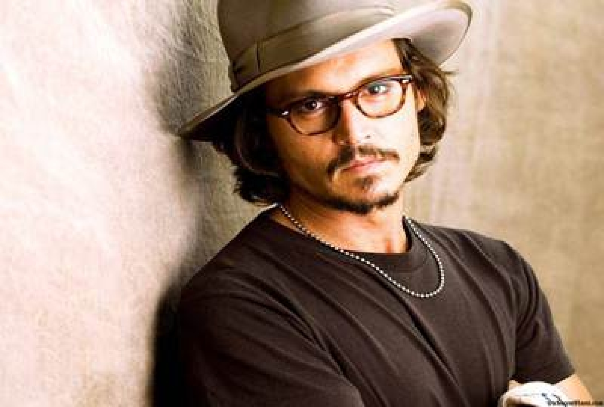 Dogged Johnny Depp ready to hit for Amber Heard