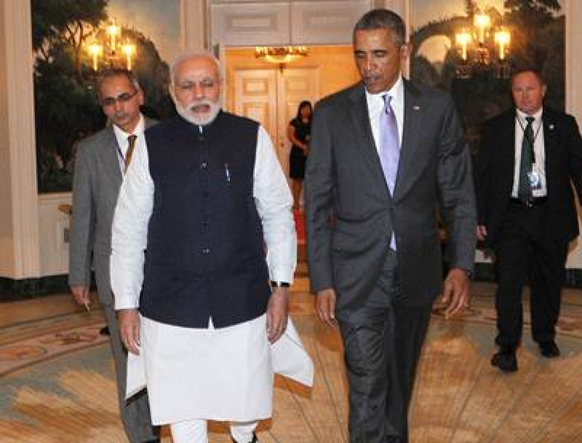 Indian Prime Minister Narendra Modi (centre L) walks with US President Barack Obama at the White House in Washington, DC, on September 29, 2014. President Barack Obama took a first chance to size up Narendra Modi, as the new Indian Prime Minister, an intriguing novice on the world stage, brought a tour which wowed New York to the White House.