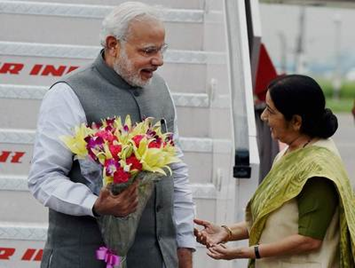 Modi's ends Japan visit, Sushma receives him at airport