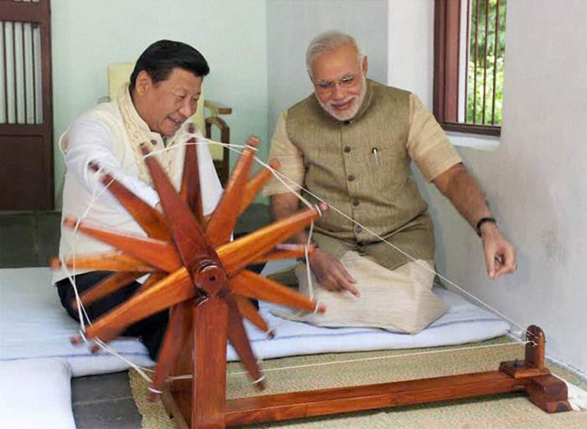 Ahmedabad: Prime Minister Narendra Modi explains about the working of spinning wheel to Chinese President Xi Jinping at Gandhi Ashram in Ahmedabad on Wednesday. PTI Photo