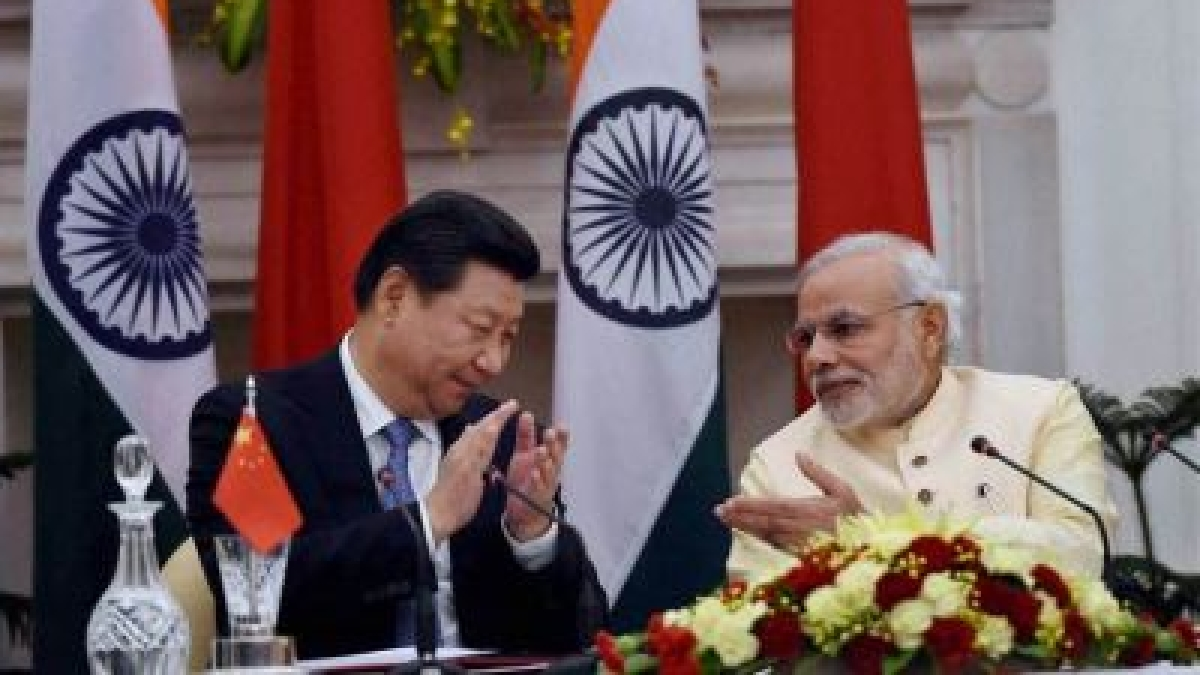 Prime Minister Narendra Modi and Chinese President Xi Jinping at a ceremony at Hyderabad House in New Delhi