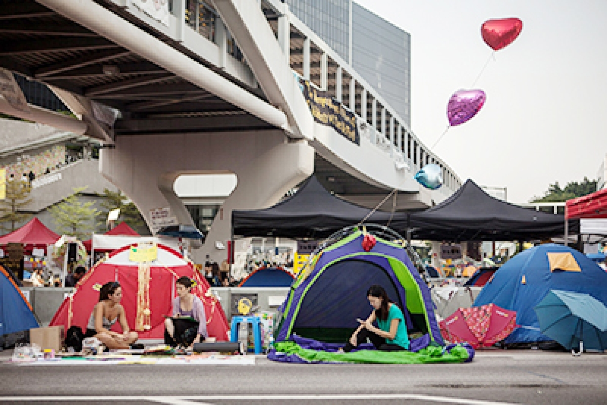 Members of the Occupied movement rest in their tents in Hong Kong.