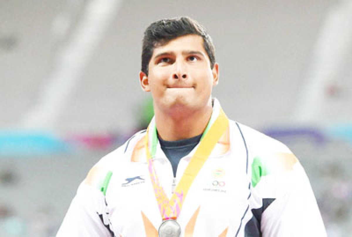 Gowda settles for silver