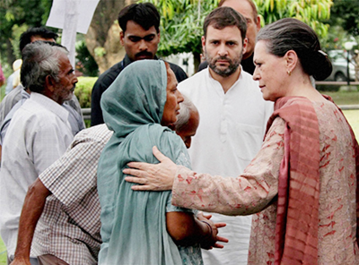 Congress President Sonia Gandhi and party Vice  President Rahul Gandhi interact with flood victims in Jammu on Tuesday