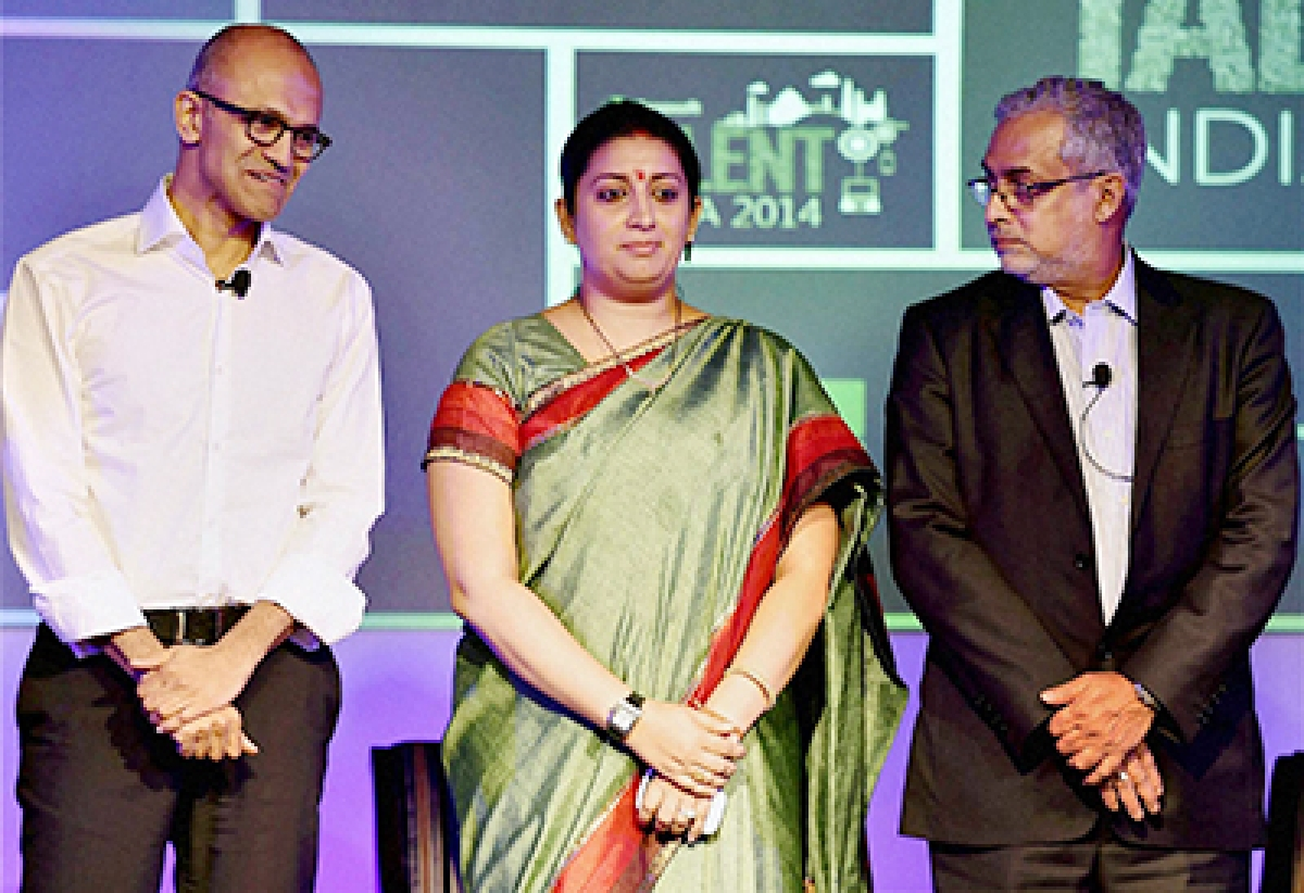 Union Human Resource Development Minister Smriti Irani flanked by  Microsoft CEO Satya Nadella (left) and Microsoft India chief Bhaskar Pramanik at Talent India 2014 Conference.