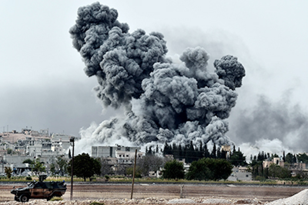 Smoke rises after a strike on the Syrian town of Kobane as known by the Kurds.