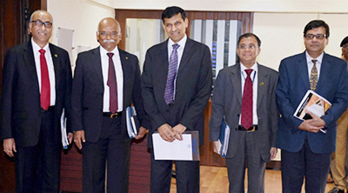 RBI Gevernor Raghuram Rajan (C) along with Deputy Governors (L to R) S S Mundra, R Gandhi, H R Khan and Urjit Patel arrive at a press conference after announcing RBI's bi-monthly monetary policy in Mumbai on Tuesday