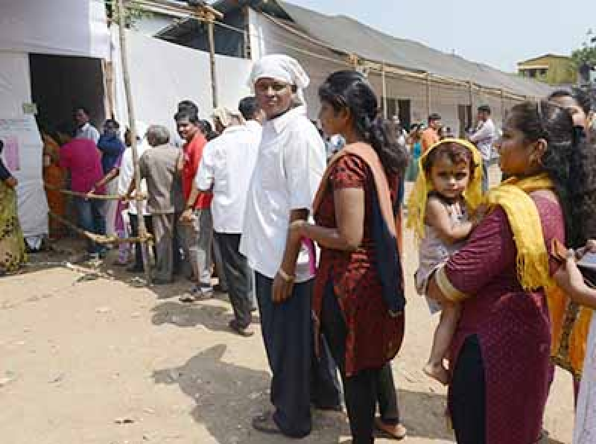The queue of voters at a poll booth set up in a makeshift tent