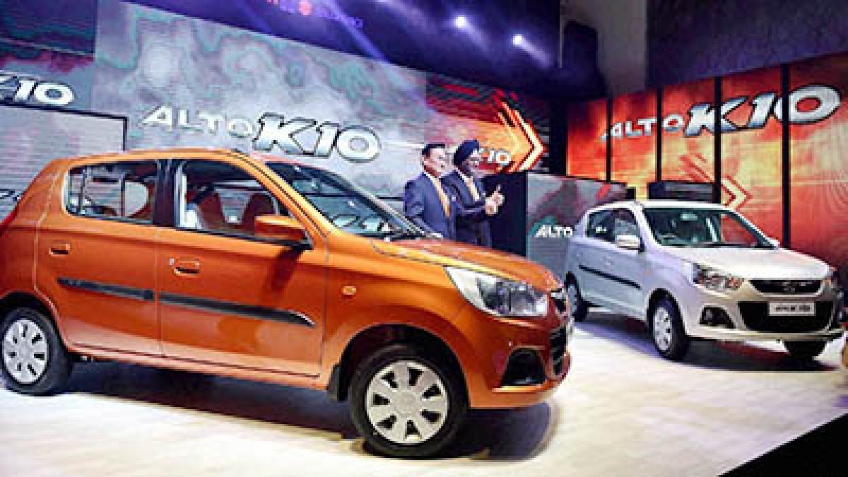 MD & CEO Kenichi Ayukawa and Executive Director,  Marketing & Sales at the launch of Maruti Suzuki's  next generation Alto K10 in New Delhi on Monday.