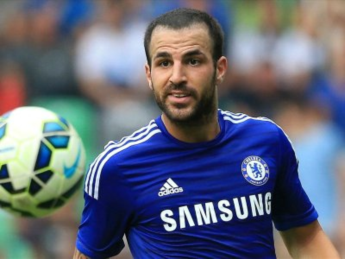 Cesc Fabregas says Lionel Messi is`happy` at Barcelona