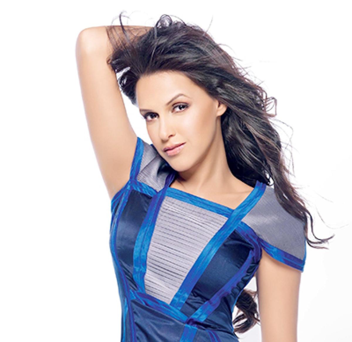 I am a full time struggler: Neha Dhupia
