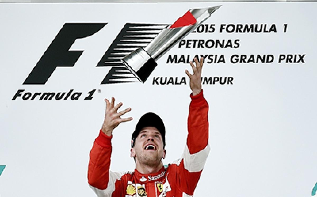 Roaring Vettel stuns Mercedes