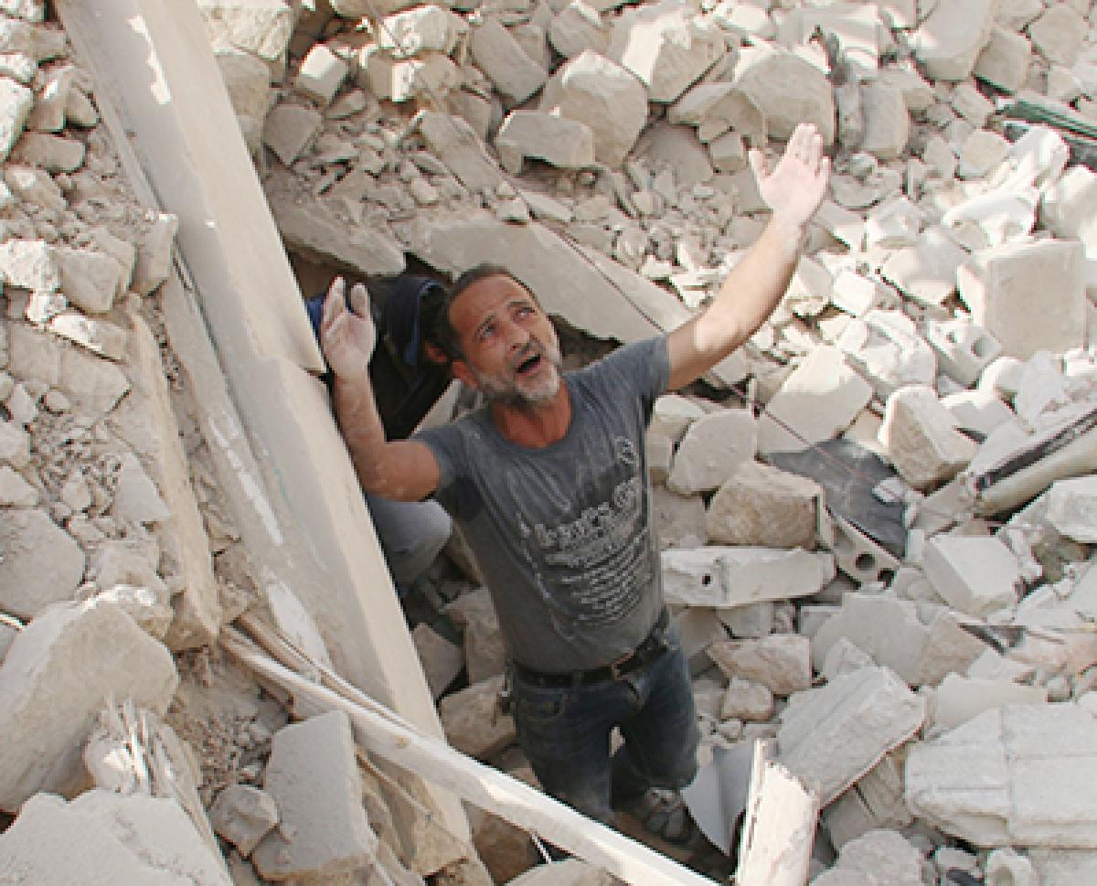 Regime barrel bombs kill 45 civilians in Syria's Aleppo