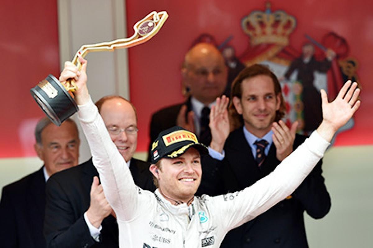 Rosberg celebrates after  Hamilton pit stop fiasco