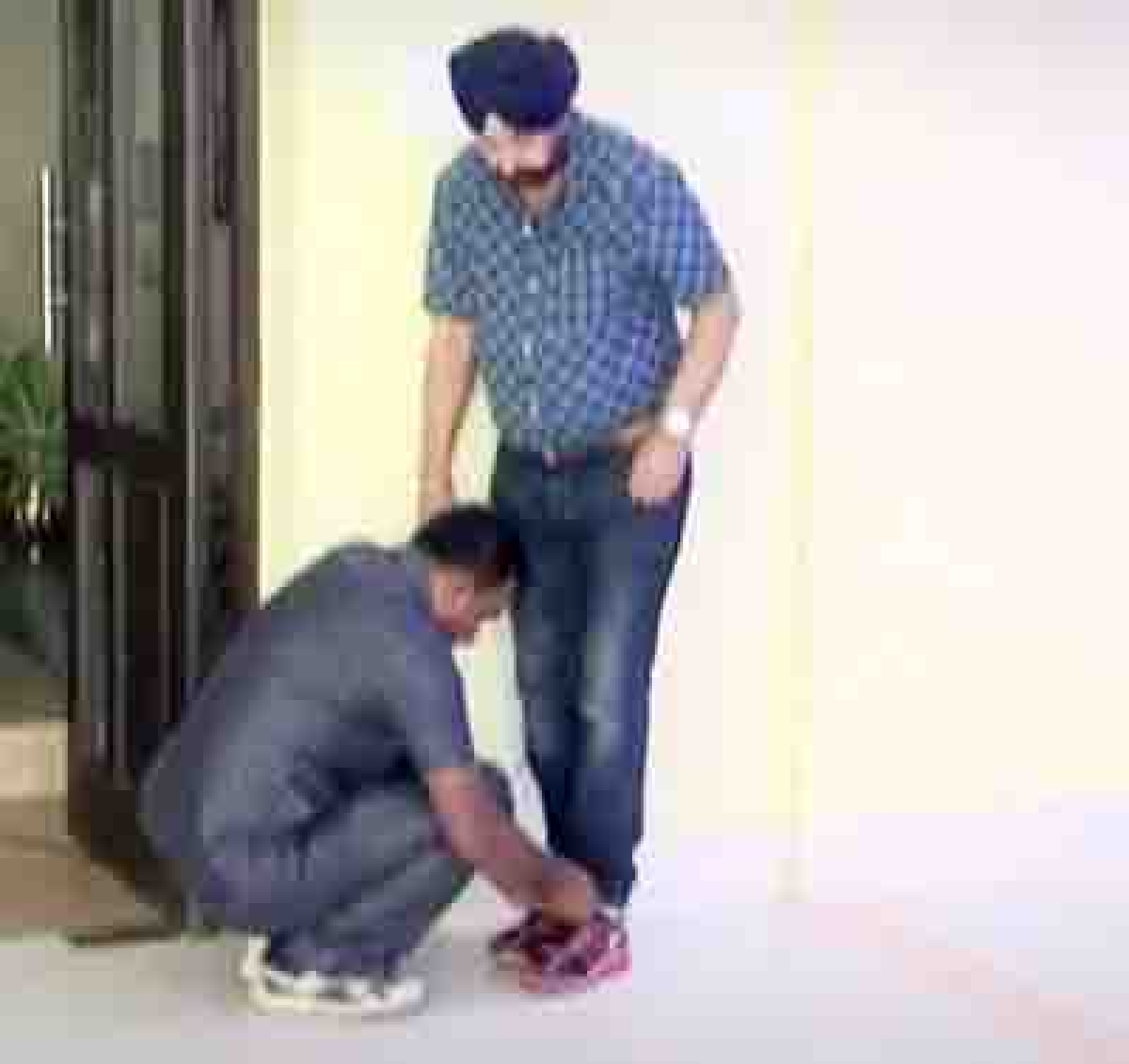 Guard caught on tape tying Bengal minister's shoelaces