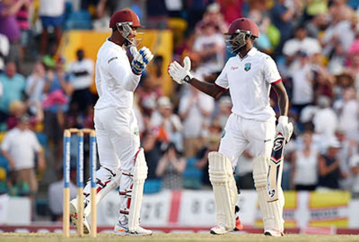 West Indies captain Denesh Ramdin (L) and Jermaine Blackwood celebrate their  victory over England at the Kensington Oval Stadium in Bridgetown, Barbados.