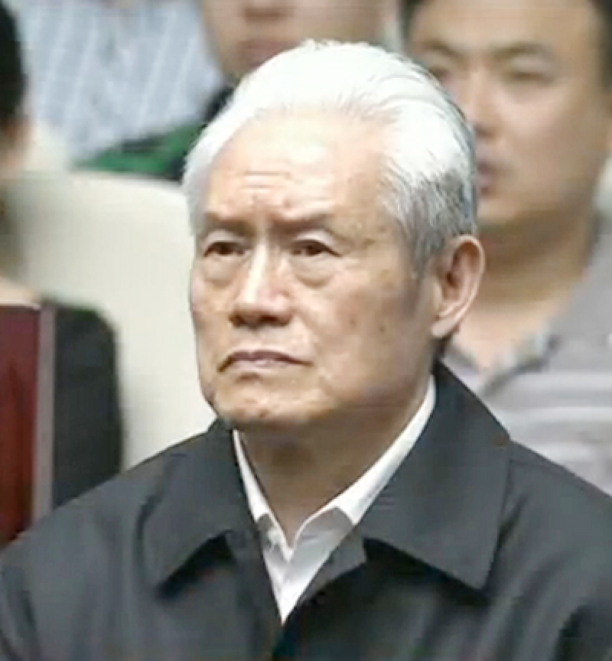 "This screen grab taken from CCTV footage shows former Chinese security chief Zhou Yongkang standing on trial at the Intermediate People's Court in Tianjin on June 11, 2015. Former Chinese security chief Zhou Yongkang, the highest ranking ex-official to be investigated for corruption in decades, was sentenced on June 11 to life in prison at a secret trial, state-media said. CHINA OUT AFP PHOTO / CCTV ----EDITORS NOTE---- RESTRICTED TO EDITORIAL USE - MANDATORY CREDIT ""AFP PHOTO / CCTV - NO MARKETING NO ADVERTISING CAMPAIGNS - DISTRIBUTED AS A SERVICE TO CLIENTS"