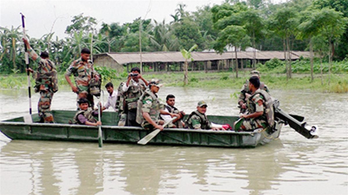 Jalpaiguri: Army personnel rescue people from flooded areas of Chapadanga in Jalpaiguri of West Bengal on Sunday.  PTI Photo