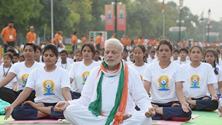 Indian Prime Minister Narendra Modi participates in a mass yoga session along with other Indian yoga practitioners to mark the International Yoga Day on Rajpath in New Delhi.