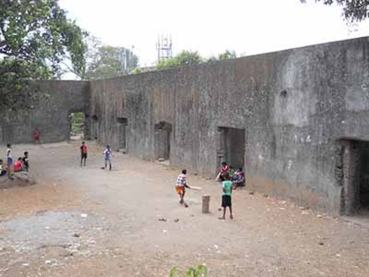 Children playing cricket in the fort premises