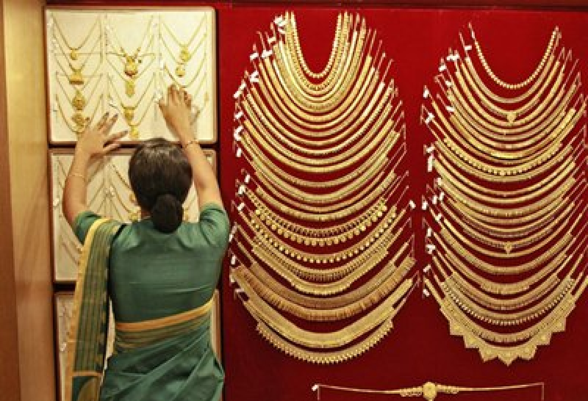 Gold edges up on stray demand, firm global trend