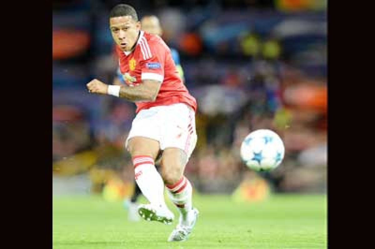 Magnificent Memphis gives Man United edge