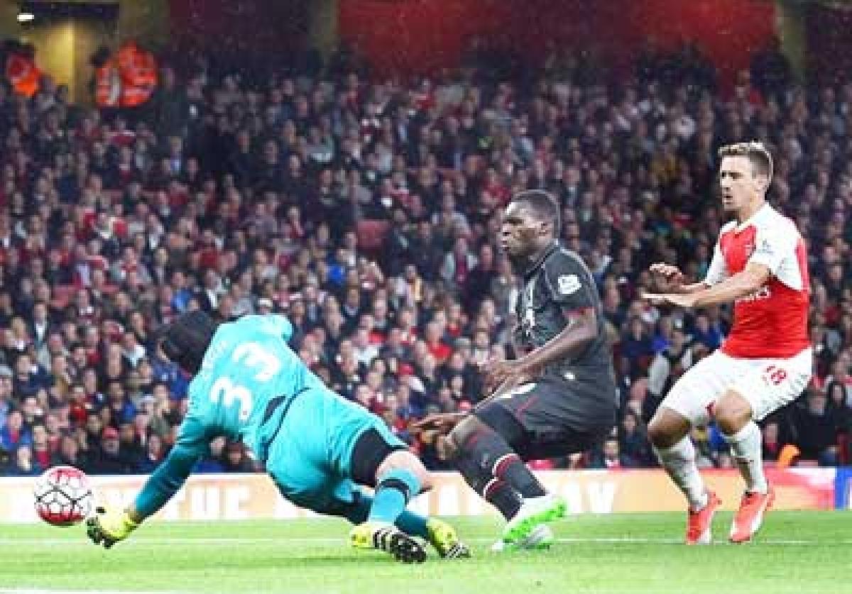 Arsenal, Liverpool share spoils in slugfest