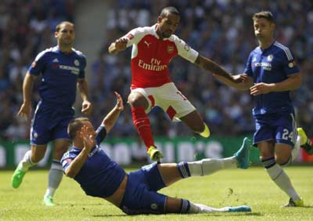 Chelsea captain Terry says defeat to Arsenal comes as warning to the defending champs
