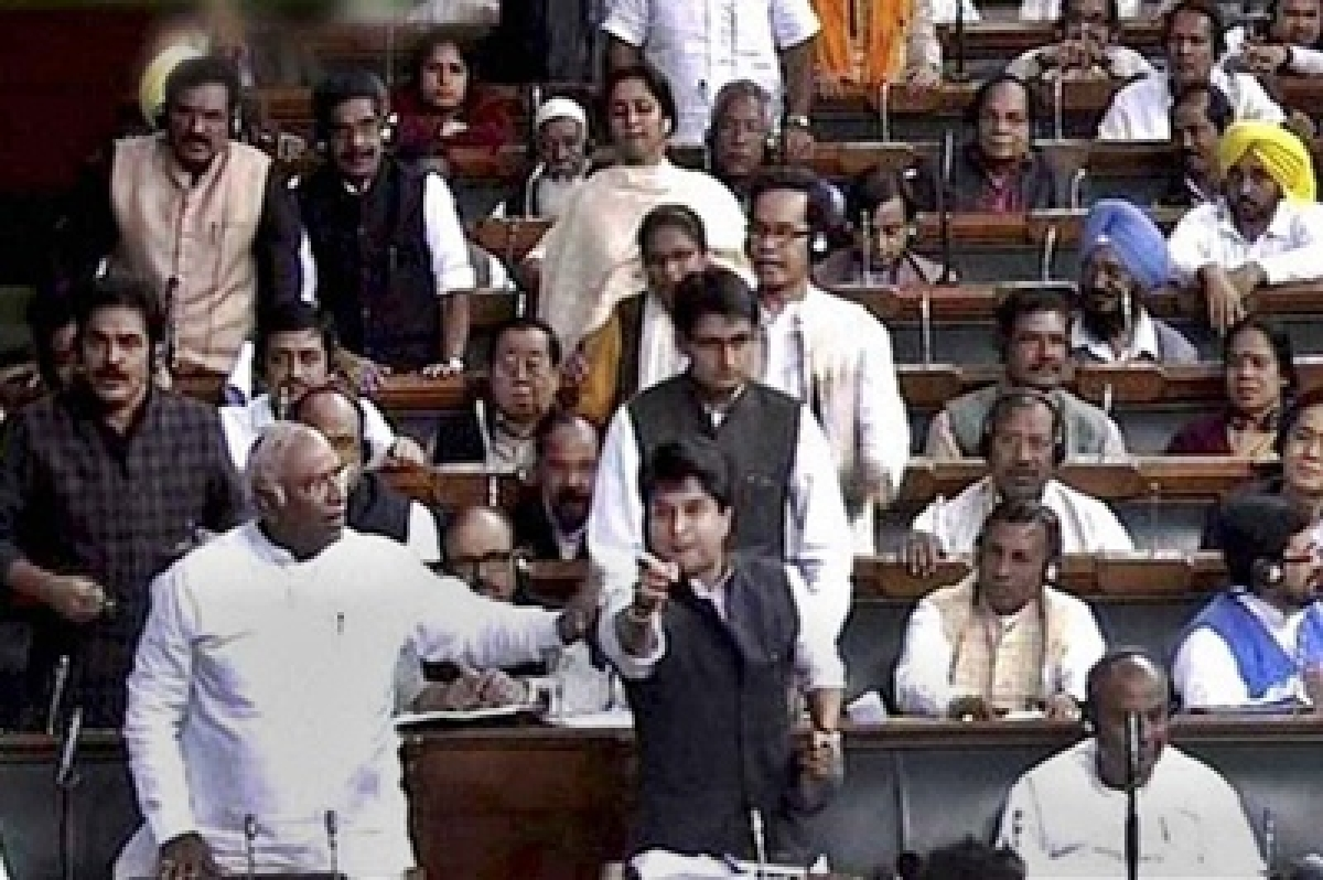 Opposition protests rock Lok Sabha, Speaker carries on proceedings in din