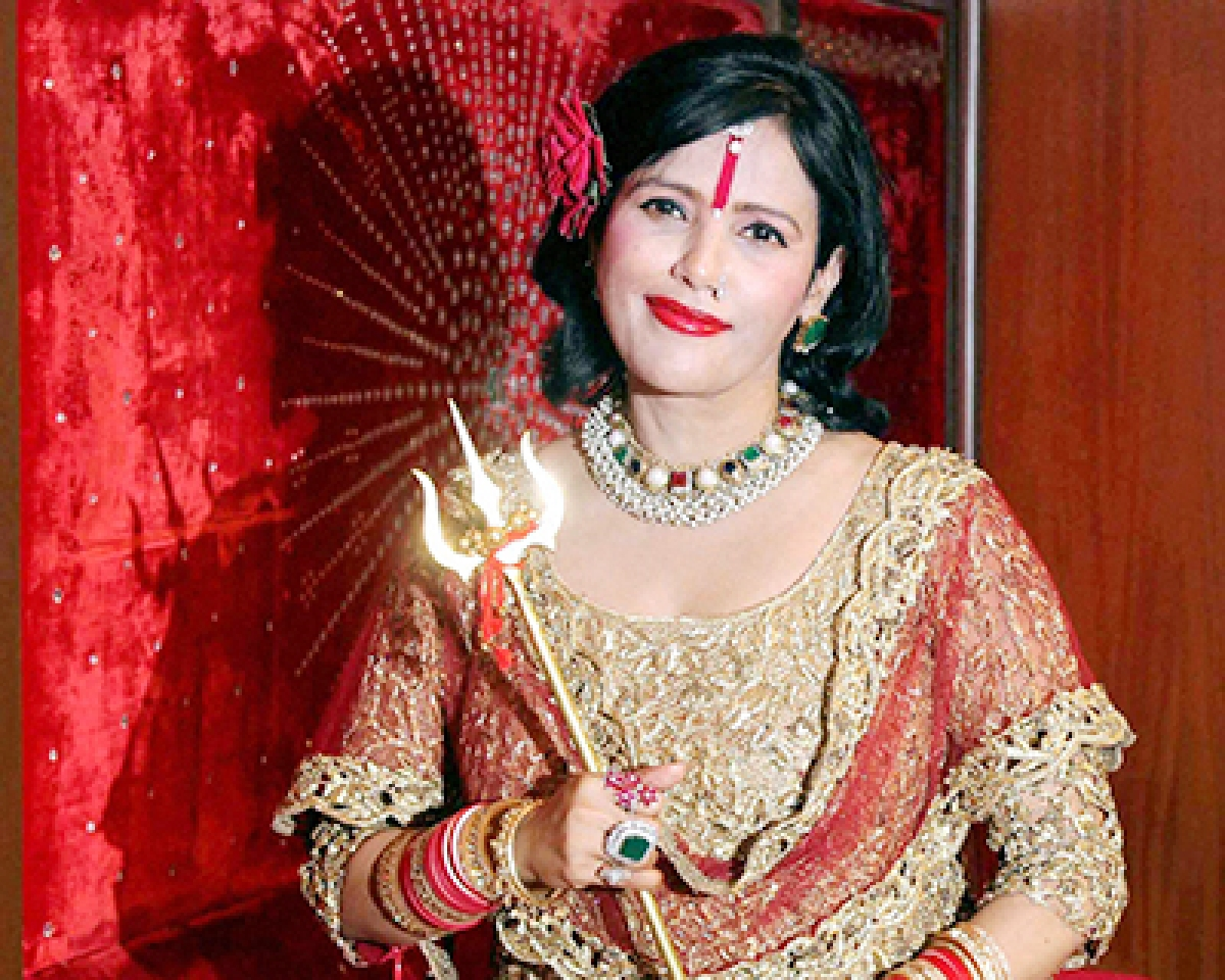 Mumbai : Radhe Maa during an interaction with the media in Mumbai on Monday. PTI Photo (PTI8_10_2015_000234B)