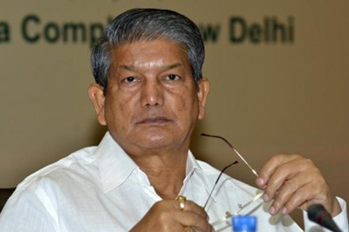 BJP seeks Rawat's resignation over controversial sting video