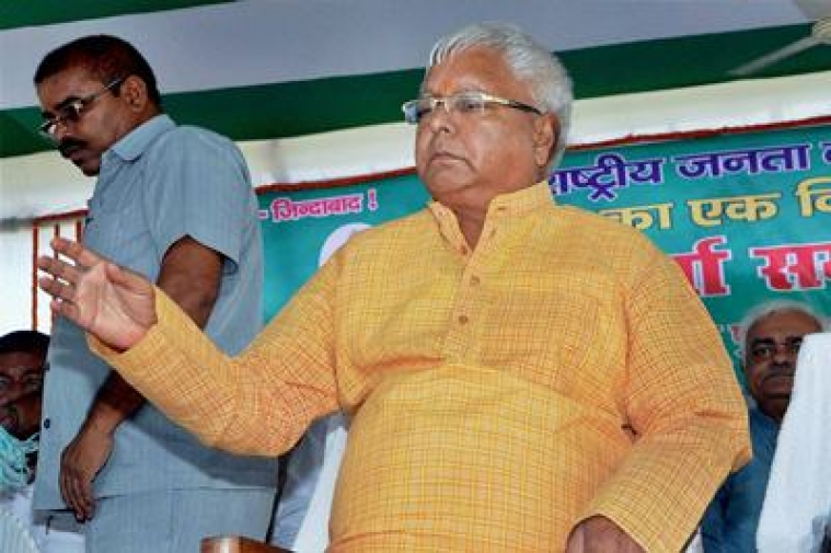 Patna: RJD Chief Lalu Prasad during party workers meeting in Patna on Sunday. PTI photo by- Amrit Jai Kishan.(PTI8_16_2015_000061B)