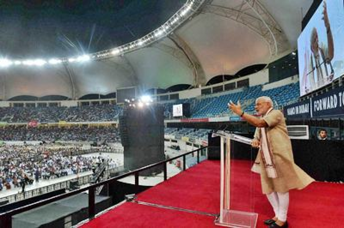 Dubai: Prime Minister Narendra Modi addresses people at a cricket stadium in Dubai on Monday. PTI Photo by Atul Yadav(PTI8_17_2015_000272B)
