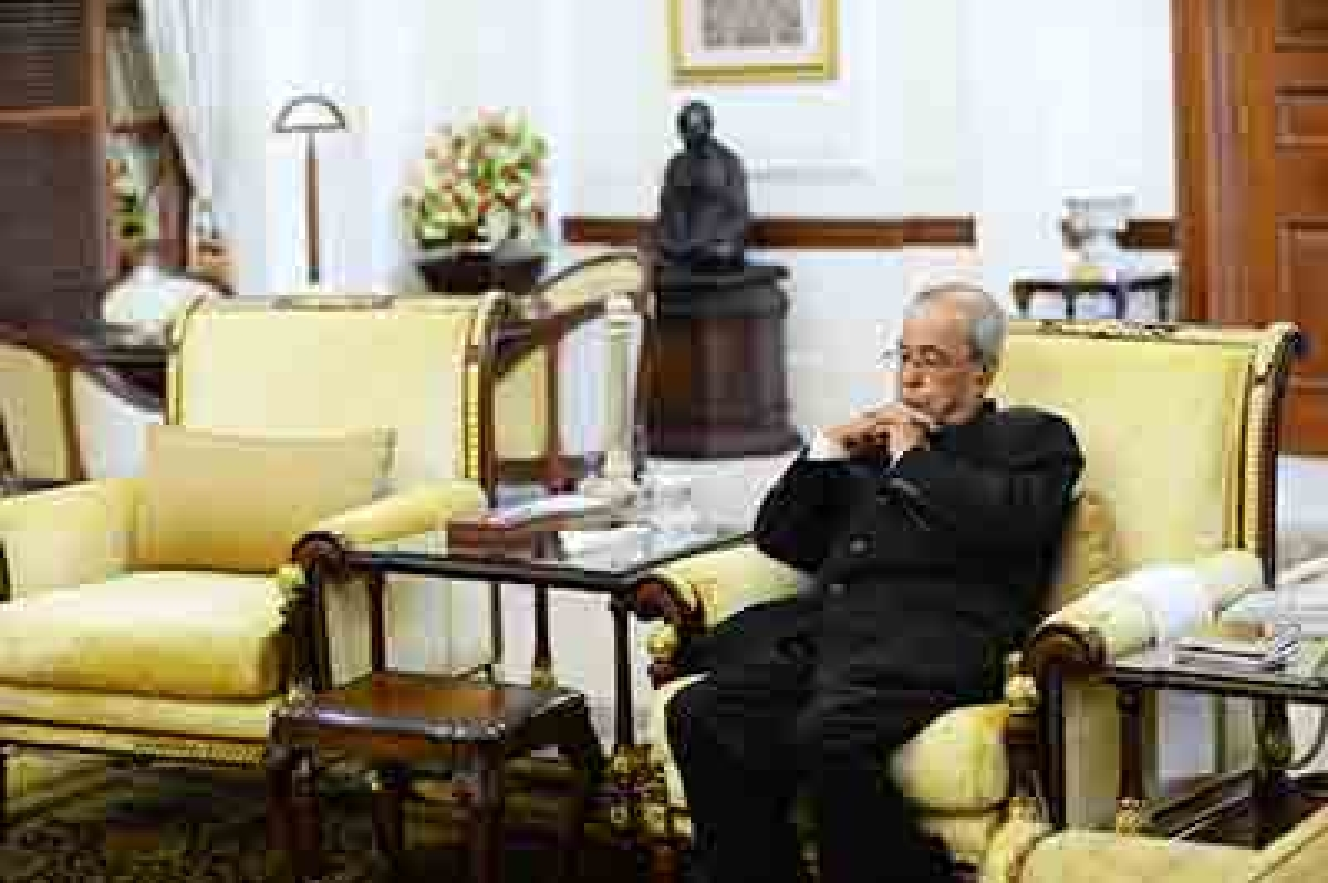Hours since wife's last rites, Prez is back to work