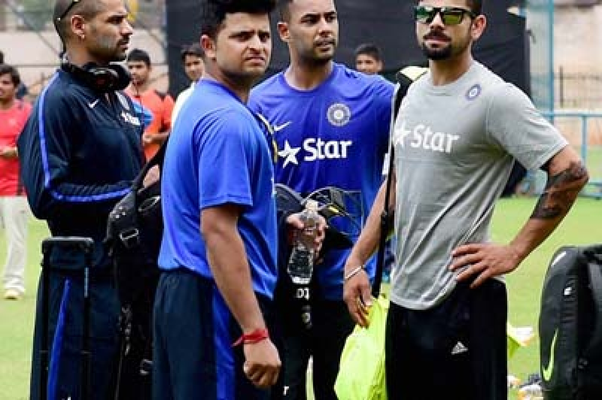 Bengaluru : Cricketer Suresh Raina,Shikhar Dhawan,Stuart Binny and Virat Kohli during the preparatory camp for the upcoming series against South Africa at NCA in Bengaluru on Thursday. PTI Photo by Shailendra Bhojak(PTI9_24_2015_000080B)