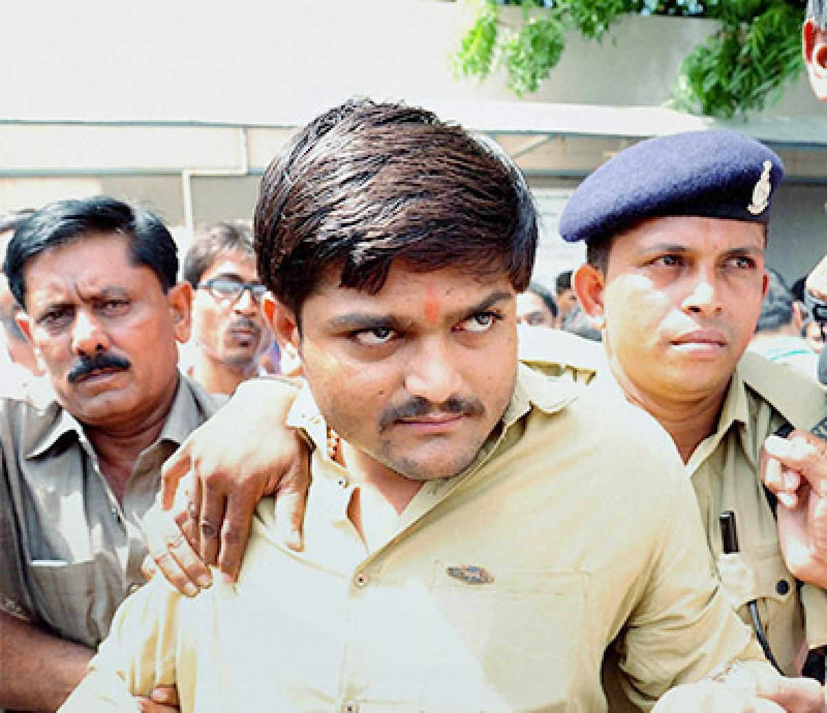 Ahmedabad: Patidar Anamat Andolan Samiti (PAAS) Hardik Patel is taken to Gujarat High court in Ahmedabad on Tuesday for a hearing in the Habeas Corpus petition application filed by his advocate. PTI Photo  (PTI9_29_2015_000078B)