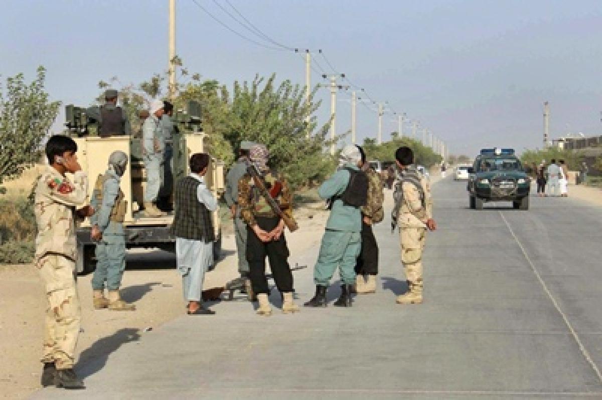 Afghan forces plan fightback after Taliban overrun key city
