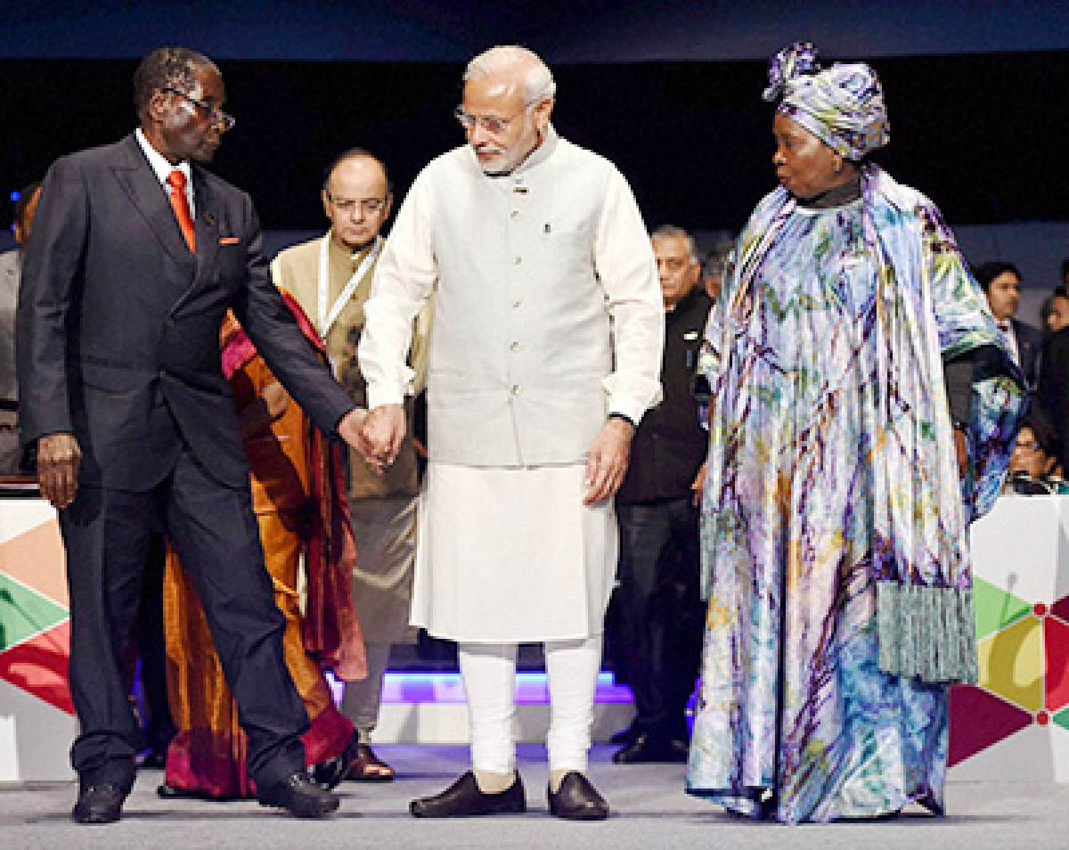 New Delhi: Prime Minister Narendra Modi along with Robert Mugabe, President of Zimbabwe, and Chairman of African Union and African Union Commission Chairperson Nkosanzana Dlamini-Zuma at the closing session of the India Africa Forum Summit at Indira Gandhi Sports Complex in New Delhi on Thursday. PTI Photo by Manvender Vashist  (PTI10_29_2015_000306B)