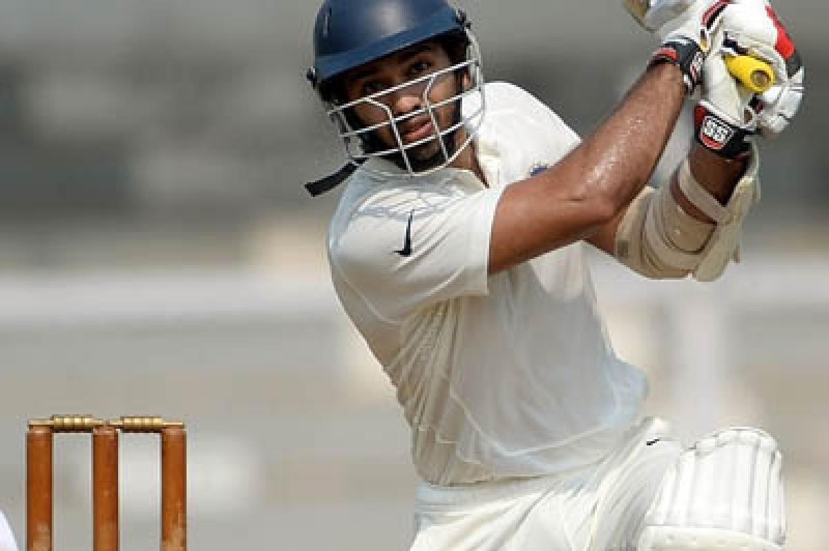 Lokesh Rahul,Naman Ojha powerBoard XI's charge