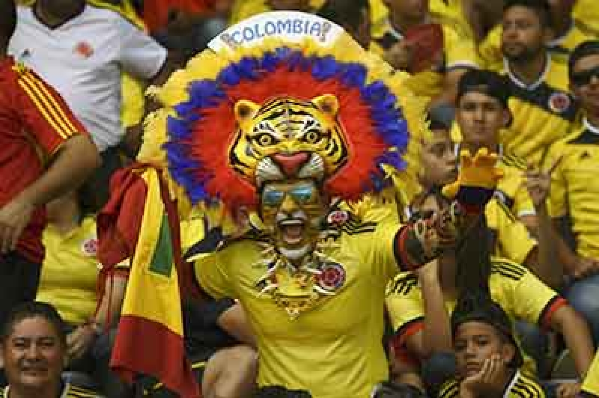 Fans of Colombia cheer for their team before the start of the Russia 2018 FIFA World Cup qualifiers match Colombia vs Peru, at the Metropolitano Roberto Melendez stadium in Barranquilla, Colombia, on October 8, 2015.      AFP PHOTO / LUIS ACOSTA